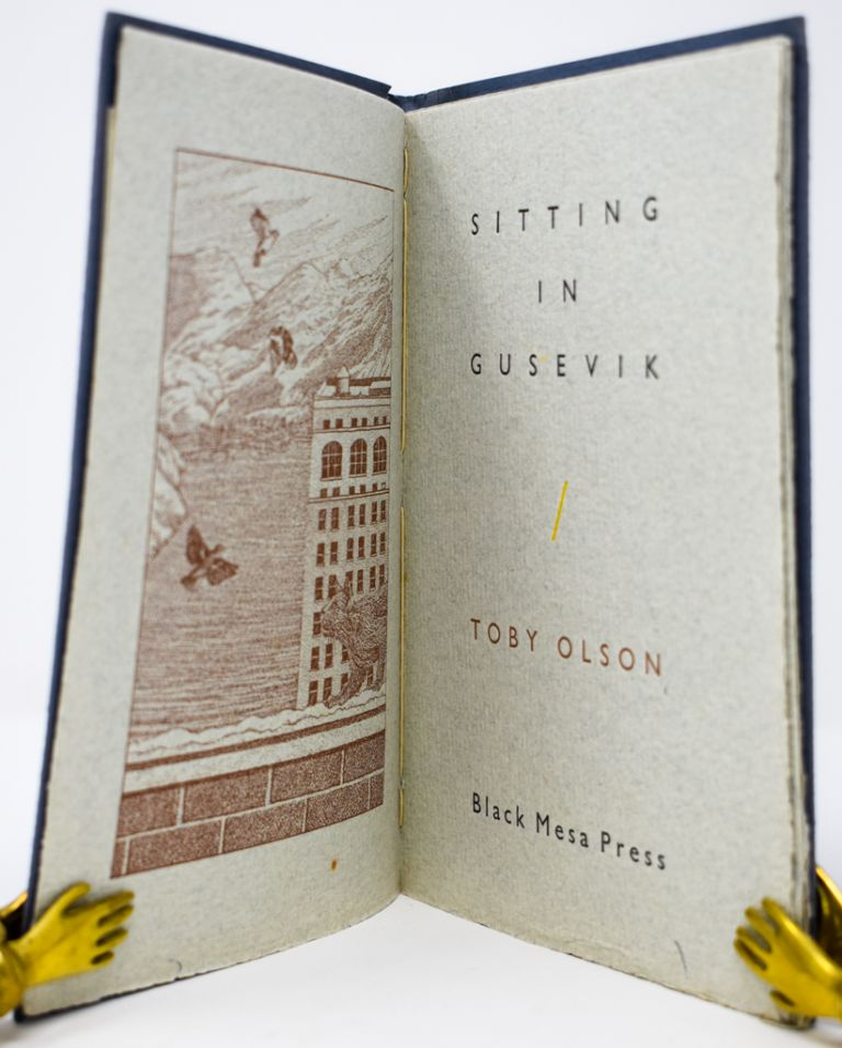 Sitting in Gusevik [Signed and Inscribed]. Toby Olson.